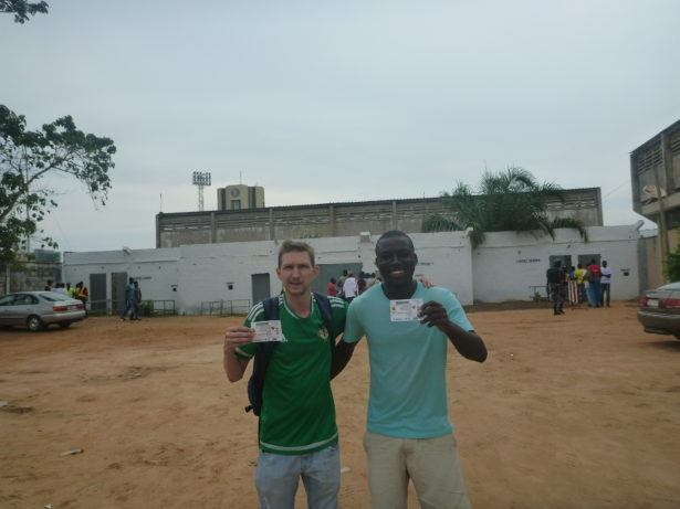 Attending the Togo v. The Gambia match at the national stadium i n Lome.