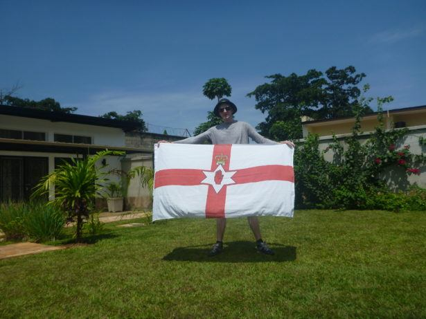 Flying the Northern Ireland flag in the back garden in Urban Lodge, Bujumbura, Burundi
